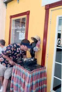 **6/4/2003** Dan posing with the Mannequin Piss outside a Belgian chocolate shop, St. Maarten