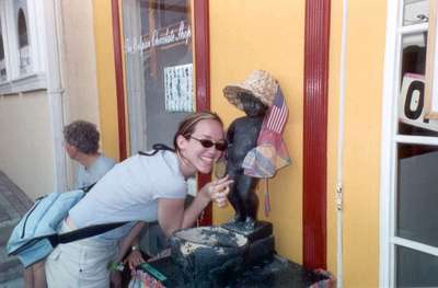 **6/4/2003** Steph posing with the Mannequin Piss outside a Belgian chocolate shop, St. Maarten