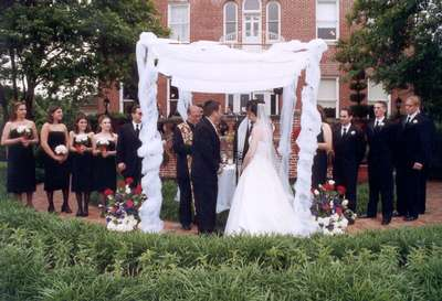Under the chuppah in front of the Mansion