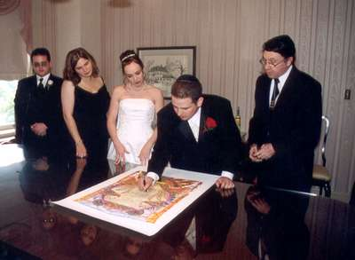 Adam, Katy, Steph, and Dan with Rabbi Brenner signing the ketubah (the Jewish marriage contract) before the ceremony.
