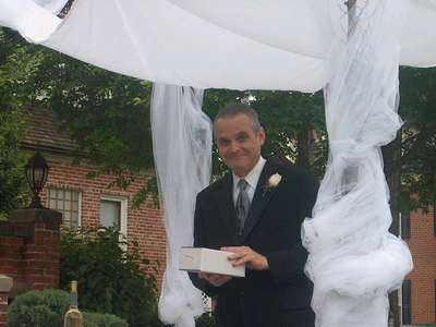 Dad bringing out the ceremony supplies (wine and the kiddush cup)(photo courtesy of Uncle Greg)