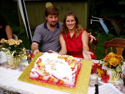 Mike and Heather with the bridal shower cake