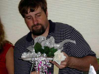 Mike arranges the ribbons for the bridal bouquet