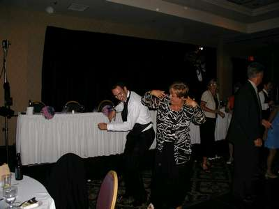 Craig showing his moves at the reception, with a family friend.