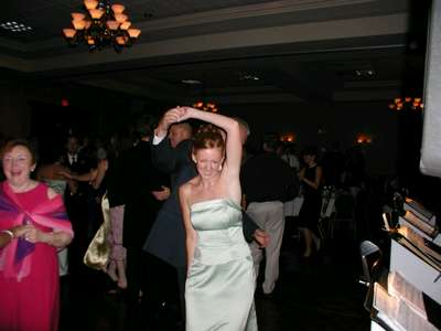 Julie dancing with her father at the reception.