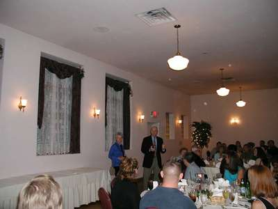 Larry and Tess giving a toast at the rehearsal dinner.