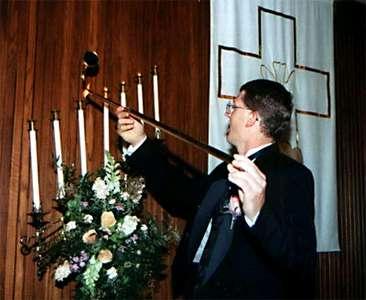 Nathan lighting candles