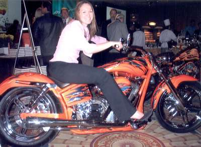 Posing on custom bike at magazine convention we worked at, DC