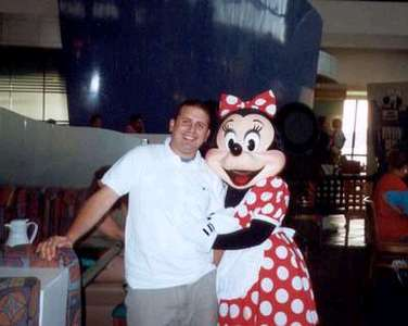 Dan posing with his favorite, Minnie.