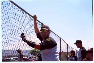 Paul, one of our groomsmen, cheers on his teammates at the softball tournament