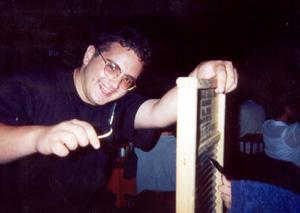 July 2000 Adam at the Hoop-Dee-Doo Review...bending the spoon!