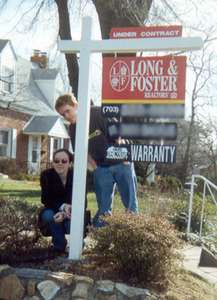 February 2000 Steph and Curt by our house--the sold sign...  :(