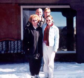 Dec 2000 Mom, Dad, Curt, and me outside in NM