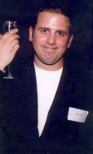 September 2002 Dan out networking..what is he holding?