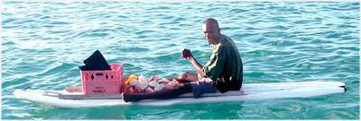 This is a picture of a shell fisherman. Not the one that Greg purchased a large conch shell from but very close!