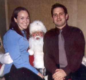 December 2002 Dan and me with Santa (at a holiday party)