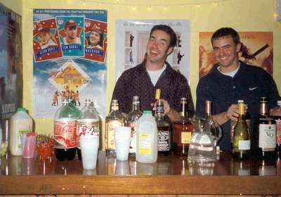 Boys will be boys. Craig and Marc (brides brothers) tending bar at our fathers 50th birthday bash.