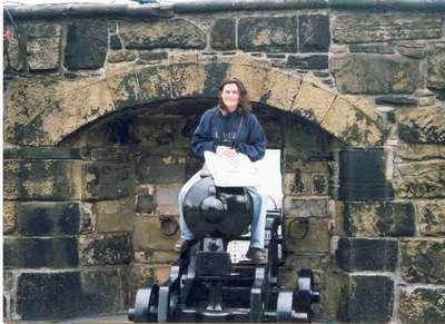 Melissa challenging a cannon in Scottland. (July 99)